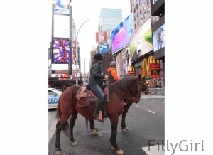 Riding-a-horse-in-nyc's-Times-Square
