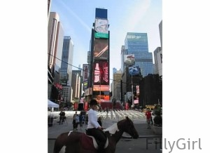 Riding-a-horse-in-times-square-where-they-drop-the ball-on-New-Year's-eve